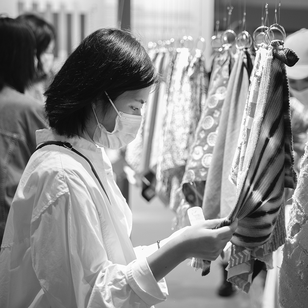 Asian woman at the Trend Forum of Intertextile Shanghai Apparel Fabrics
